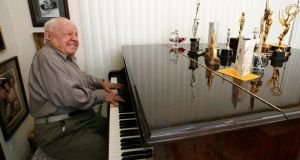 Actor Mickey Rooney plays a piano at his home in Westlake Village, California in this February 14th , 2007 file photo. Photograph: Mario Anzuoni/Files/Reuters