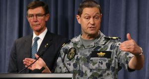 Air chief marshal Angus Houstonlooks on as Commodore Peter Leavy from the Royal Australian Navy answers a question from a reporter during a press conference for the continuing search of missing Malaysia Airlines Flight MH370 in Perth, Australia. Photograph: Paul Kane/Getty Images