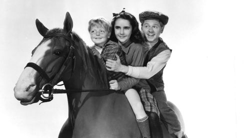 Elizabeth Taylor and Mickey Rooney in a scene from the film National Velvet, made in 1944. Taylor died three years before Rooney passed away. Photograph: MGM/Handout/Reuters