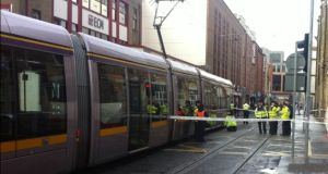 The scene in Dublin city centre today where a woman in her 30s has been killed following a collision between a Luas and a car. Photograph: Sorcha Pollak