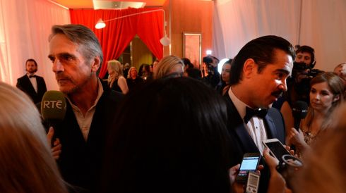 The eye of the storm: Jeremy Irons and Colin Farrell busy talking. Photograph: Dara Mac Dónaill/The Irish Times