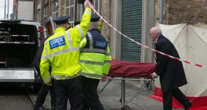 A body its taken from the scene of the fatal Luas crash in the centre of Dublin today. Photograph: Gareth Chaney/Collins