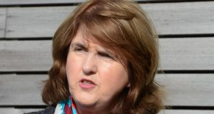 'I think people in the Labour Party have made it clear over quite a lengthy period of time that they would very much appreciate if Eamon was able to work full time in a ministry at home,' Joan Burton said.  Photograph: Cyril Byrne / The Irish Times