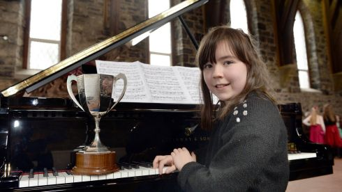 Nora Ronan (10), Palmerstown, after winning 1st prize in the Deirdre Gibson Junior Piano Forte Solo (D) U11 at the Feis Ceoil in St Mary's Church Hall, Dublin. Photograph: Brenda Fitzsimons/The Irish Times