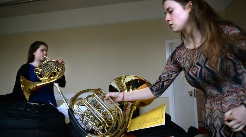Louise Sullivan, Lauragh, Co Kerry (left) and Ellen McCullagh, Rathgar, Dublin, prepare for the junior/senior french horn competition at the Feis Ceoil in the RDS. Photograph: Dara Mac Dónaill/The Irish Times