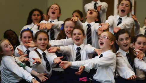 Pupils from Notre Dame junior school, Churchtown, Dublin, warm up ahead of the Junior Unison competition. Photograph: Brian Lawless/PA Wire