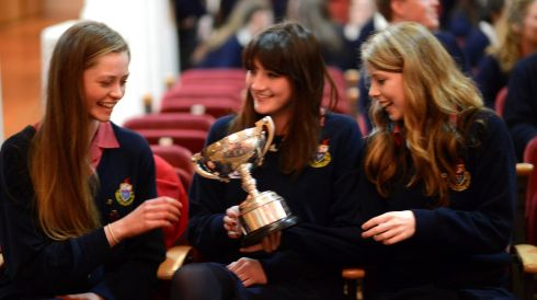 Aisling Redden (left) with Molly Robb and Aisling Dooley, of Wesley College, celebrate with the  Patrick Gifford Cup. Photograph: Cyril Byrne/The Irish Times