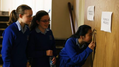 Pupils from Mount Sackville (from left) - Alannah O'Connor (13), Kate Elliott (14) and Elaine Zhao (14) - wait for an opportunity to enter the concert hall during the post-primary schools choirs competition. Photograph: Brian Lawless/PA Wire