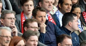 Tottenham Hotspur manager Tim Sherwood watches from the stands during the game against Liverpool at Anfield. Photograph: Martin Rickett/PA Wire