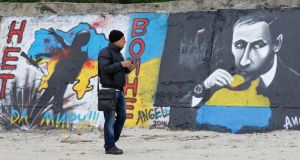 A man looks at a graffiti produced to support the territorial integrity of Ukraine and to protest Russia's annexation of the Black Sea peninsula of Crimea in Odessa . Photograph: Yevgeny Volokin/Reuters