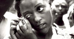 Angelique Mukagashugi, whose mother and brother were the only members of her entire family to survive the slaughter by members of the militia in Kiborongo, South Eastern Rwanda, May 1994. Photograph: Frank Miller