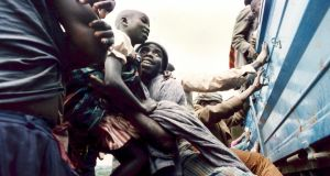 Refugees scrambling aboard a truck on the border of Rwanda to reach the main refugee camp at Benako in Tanzania in May 1994. Photograph: Frank Miller