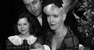 Bob Geldof pictured in March 1989 with his wife Paula Yates, their five-year-old daughter Fifi Trixiebelle and a newborn Peaches at St Mary's Hospital in Paddington, London. Peaches Geldof died today at the age of 25. Photograph: Martin Keene/PA Wire