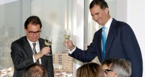 Spain's Prince Felipe (right) toasts with Catalan president Artur Mas after an inauguration ceremony at the new headquarters of fashion and fragrance company Puig in Hospitalet de Llobregat, near Barcelona, on Monday. Spain's parliament is to vote tomorrow on a petition from the Catalan parliament seeking the power to call a popular vote on the region's independence. Photograph: Toni Albir/Reuters