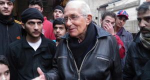 Dutch Jesuit Fr Frans van der Lugt chats with civilians in the besieged area of Homs on January 29th. Fr van der Lug was shot dead by unidentified gunmen in Homs. Photogtaph: Yazan Homsy/Reuters