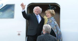 President Micheal D Higgins and his wife Sabina leaving Casement Aerodrome in Baldonnel yesterday for a four-day State visit to Britain.  Photograph: Cyril Byrne