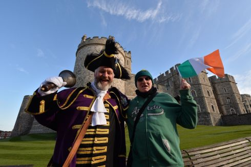 Chris Brown, Town Crier of the Royal Borough of Windsor and Maidenhead outside Windsor Castle with Richard O'Neill , originally from Dunmanway and now  living in London. Photograph: Alan Betson/The Irish Times