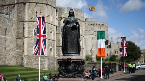 Queen Victoria looks on outside Windsor Castle, decorated with the Irish tricolour and Union Jack flags. Photograph: Peter Macdiarmid/Getty Images