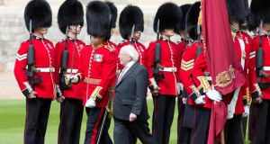 President Michael D Higgins inspects a Guard of Honor during the welcoming ceremony at Windsor Castle. Photograph: Neil Hall/EPA