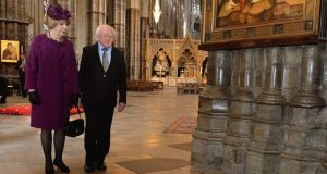 President Michael D Higgins and his wife Sabina, walk up to the floor memorial to Earl Mountbatten of Burma and his wife, during their visit to Westminster Abbey in London today. Photograph: John Stillwell/PA Wire
