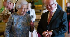 President Michael D Higgins and Queen Elizabeth II viewing Irish related items from the Royal Collection in Windsor Castle, Berkshire. Photograph: EPA/JUSTIN TALLIS
