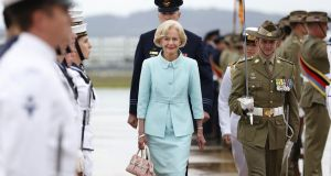 Quentin Bryce inspects the Federation Guard during a ceremony to mark the end of her term as Australia's governor general, in Canberra last month. Prime minister Tony Abbott subsequently announced that Ms Bryce had been made a dame. Photograph: Stefan Postles/Getty Images