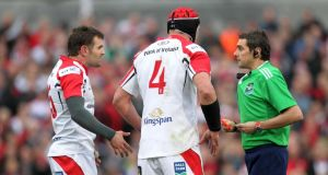 Referee Jerome Garces shows Jared Payne a red card after just four minutes of the Heineken Cup quarter-final against Saracens at Ravenhill. Photo: Darren Kidd/Inpho