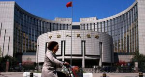 The People's Bank of China has argued that an open capital account would improve the quality of Chinese foreign assets, promote cross-border use of the renminbi and help the country's enterprises restructure. Photograph: Reuters/Petar Kujundzic