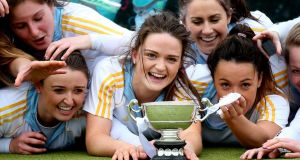 Sarah Greene and her UCD team-mates celebrate their Irish Senior Cup final victory over Pembroke Wanderers. Photo: James Crombie/Inpho