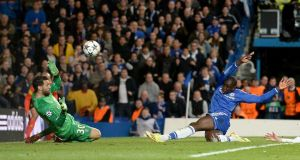 Chelsea's Demba Ba stretches to score his side's second goal in the 87th minute of the  Champions League quarter-final second leg match at Stamford Bridge. Photograph: Andrew Matthews/PA