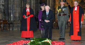 President Michael D Higgins, with his wife Sabina Coyne, at the grave of the Unknown Warrior in Westminster Abbey. Photograph: Anthony Harvey/Getty Images