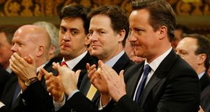 Prime minister David Cameron (right), Labour Party leader Ed Miliband (second left) and deputy prime minister Nick Clegg (centre). Photograph: Lefteris Pitarakis/PA Wire