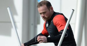 Wayne Rooney attends a training session on the eve of the  Champions League quarter final match between Bayern Munich and Manchester United at the  Allianz Arena, Munich. Photo: Peter Powell