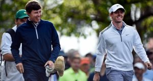 Amateur Matthew Fitzpatrick of England (left) and Rory McIlroy  walk together during a practice round prior to the start of the 2014 Masters Tournament at Augusta National Golf Club. Photograph: Harry How/Getty Images