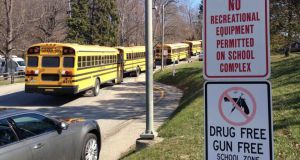 School buses  parked outside Franklin Regional High School after a stabbing incident in  Murrysville, Pennsylvania today. Photograph: Reuters