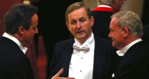 Taoiseach Enda Kenny (centre) Northern Ireland Deputy First Minister  Martin McGuinness (right) talk with  British prime minister David Cameron at the state banquet in Windsor last night. Photograph: Reuters