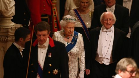 President Michael D Higgins (right) and Britain's Queen Elizabeth II arrive prepare to take their seats. Photograph: Dan Kitwood/PA Wire