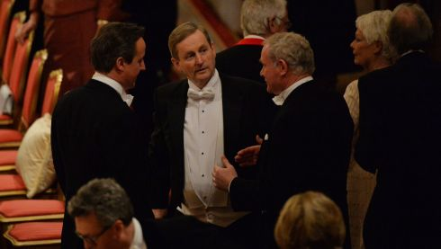 British prime minister David Cameron and Taoiseach Enda Kenny listen to Deputy First Minister  Martin McGuinness  during the banquet held  at Windsor Castle. Photograph: Alan Betson/The Irish Times
