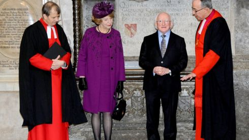 While paying their respects at the Mountbatten memorial, Sabina Higgins wears a Louise Kennedy magenta coat and crepe dress decorated with black jet beading.