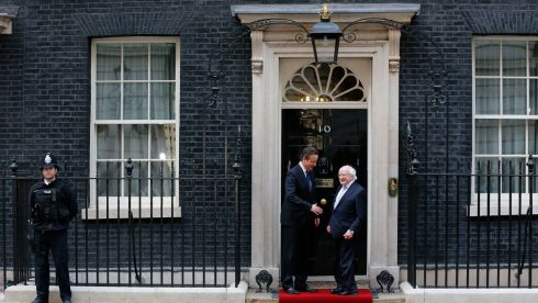 British prime minister David Cameron greets President  Higgins as he arrives at Number 10 Downing Street. PhotographL Stefan Wermuth/Reuters