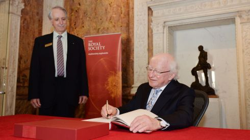 Prof John Pethica vice president Royal Society and  President Michael D Higgins, signing the visitors book  during his visit to the Royal Society. Photograph: Alan Betson/The Irish Times