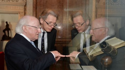 Keith Moore , Librarian at the Royal Society and  President Michael D Higgins,  viewing Robert Boyles Chemical notebooks and letters  during a visit to the Royal Society. Photograph: Alan Betson/The Irish Times