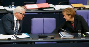 German chancellor Angela Merkel of the CDU  chats with foreign minister Frank-Walter Steinmeier of the SPD in the Bundestag on Wednesday. The two have presented a united front on a range of issues, but testing times lie ahead for the coalition partners. Photograph: Fabrizio Bensch/Reuters