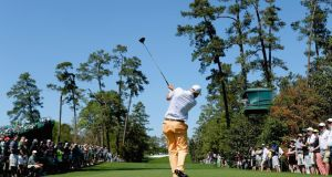 Bill Haas of the United States hits his tee shot on the 18th  at Augusta National. Photograph: Harry How/Getty Images