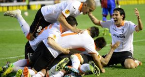 Valencia players celebrate the   fourth against  FC Basel at Mestalla stadium. Photograph: Georgios Kefalla / EPA