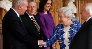 Queen Elizabeth with  President Michael D Higgins (right) greet Northern Ireland's Deputy First Minister Martin McGuinness (left), and First Minister Peter Robinson (2nd left) and British  Secretary of State for Northern Ireland Theresa Villiers. Photograph: Getty