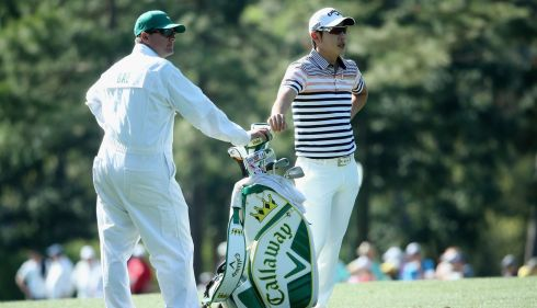 Sang-Moon Bae of Korea waits alongside caddie Matt Minister on the 14th hole.  Photograph: Andrew Redington/Getty Images