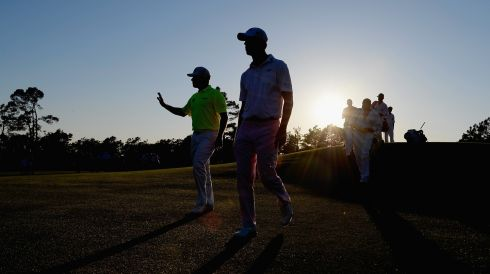 Lee Westwood of England and Harris English of the US walk to the 18th tee box.  Photograph: Harry How/Getty Images