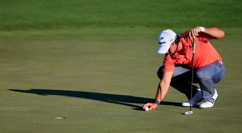 Jason Day of Australia lines up his putt on the 18th hole. Photograph: Rob Carr/Getty Images