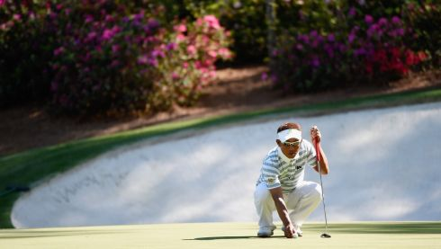 Thongchai Jaidee of Thailand lines up a putt on the 13th. Photograph: Harry How/Getty Images